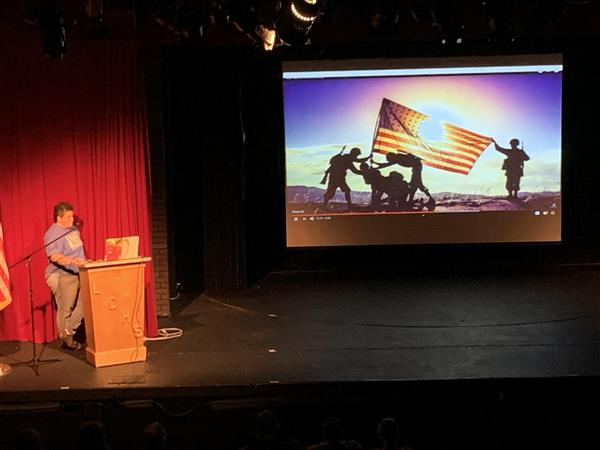Teacher Angel Cantu, Navy Veteran, Presenting at the Middle School Veterans Day Assembly.<hr><br>