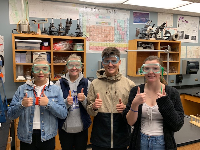 Students Give a Thumbs up in a Chemical Reaction Lab in Hinderman's class<hr><br>